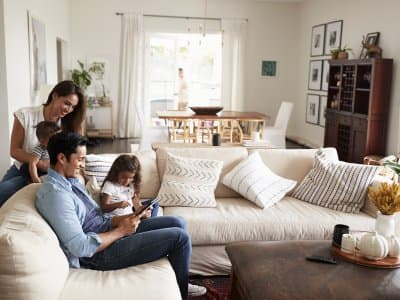 Young family smiling in living room