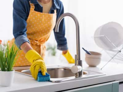 Person cleaning kitchen sink