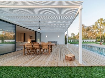 Modern home back patio with pool