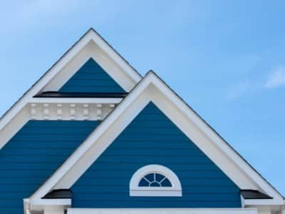 House with vinyl siding painted blue