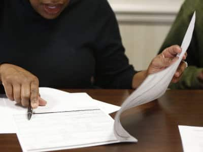 Home buyer signing paperwork at closing.