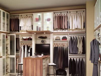 Custom closet system with shelving and a desk