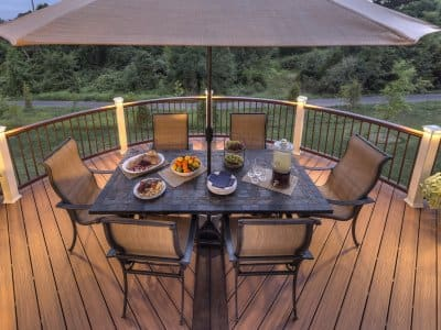 trex deck and railing with table and chairs