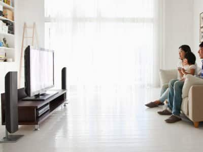 A family watching TV in living room