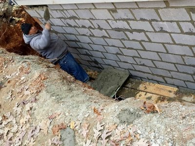 Worker building a support wall