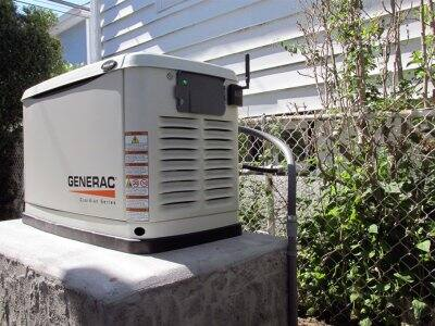 generac backup electric power generator outside home