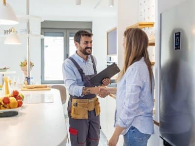 Contractor shaking hands with customer