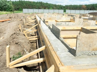home foundation of concrete and wood