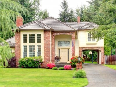 Large suburban home with brick siding