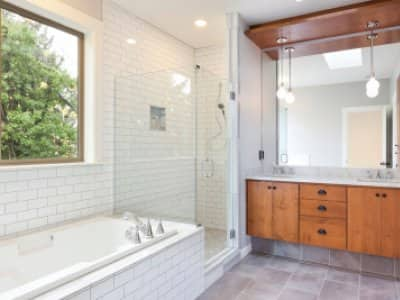 Modern bathroom with white subway tile and wood cabinets