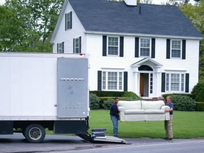 Movers loading furniture in truck