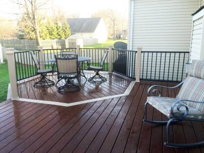 new wood deck with area with defined dining and seating area