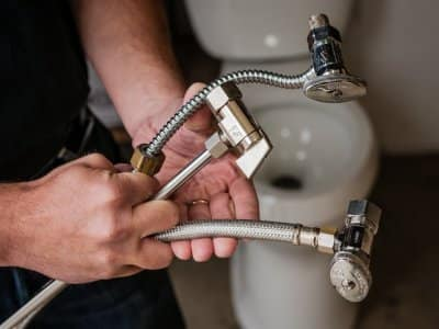 Plumber holding pipes