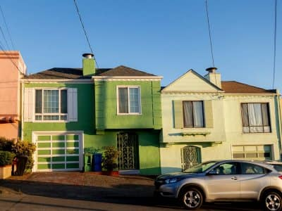 Powerlines running to row of houses