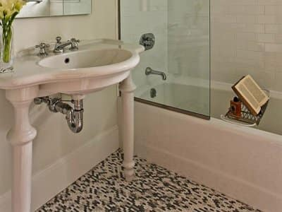 bathroom shower and tub with sink and tile floor