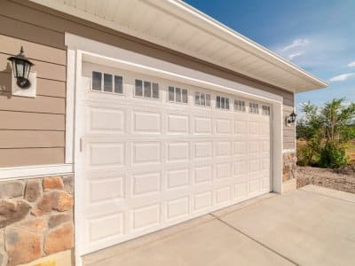 a tan garage door of a home garage