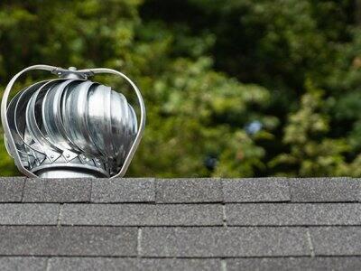 A turbine ventilator on top of a roof