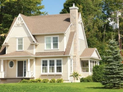 Cottage home with a peaked, shingle roof