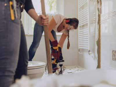 Woman remodeling bathroom