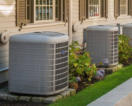 A heating and cooling system situated outdoors
