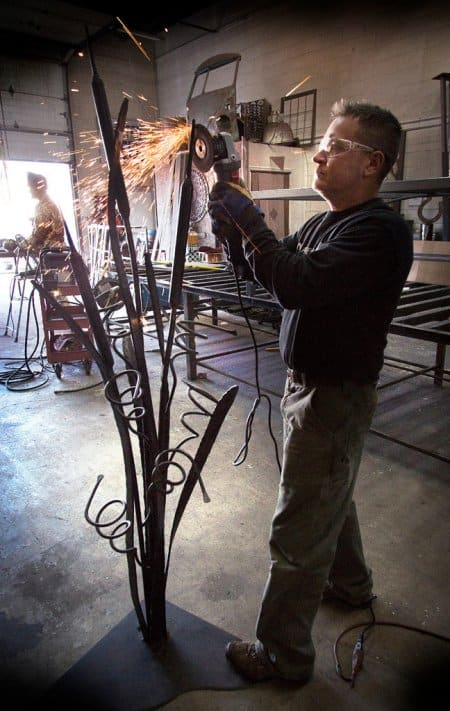 Ryan Feeney of Indy Art Forge completing a standing wine rack