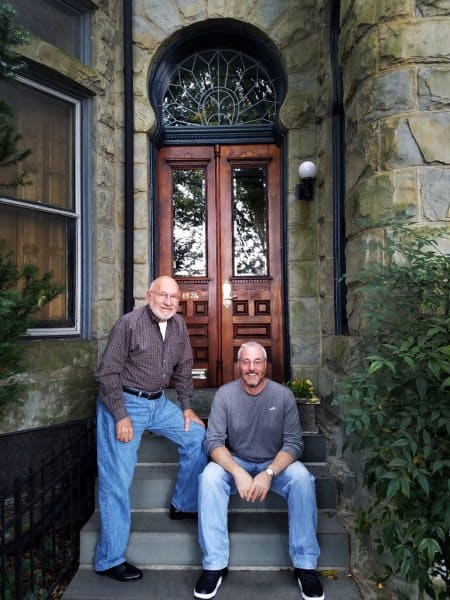 Baltimore homeowners Thom Shipley and Chris Taylor in front of their remodeled historic home