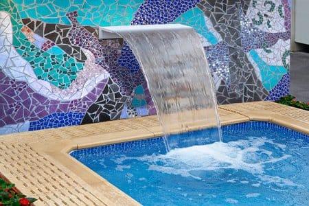 blue purple mosaic water wall with waterfall