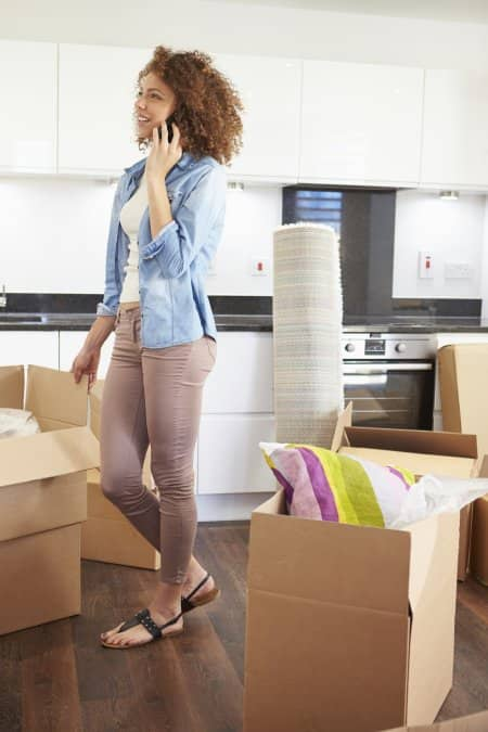 woman packing and talking on phone