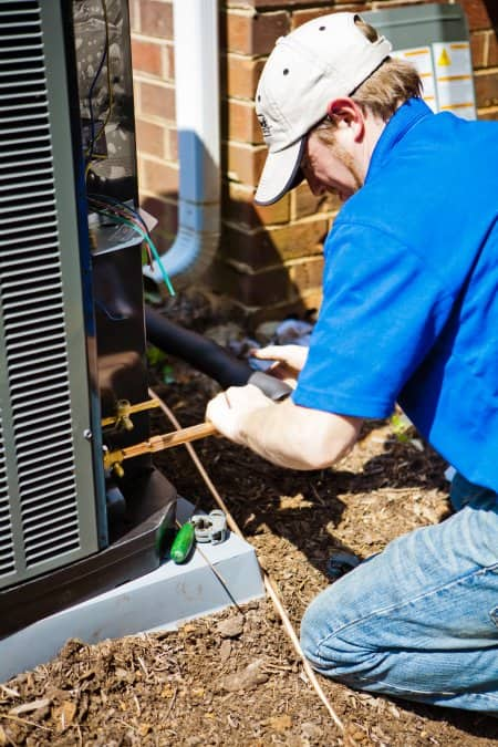 HVAC contractor installing an heating and air conditioning unit