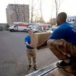 Moving company employees loading a moving truck