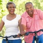 couple on bikes smiling and laughing