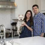 Gillian and Wesley Lackey proudly show off their kitchen, which was completely gutted and remodeled during the seven-month process. (Photo by Brandon Smith)