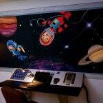 space-themed mural in kid's bedroom