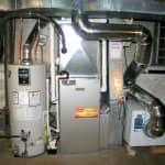 New furnace, air conditioner, water heater and whole-house dehumidifier installed in a home basement.