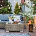 Patio sitting area with hanging lights (Photo by Photographee.eu – stock.adobe.com)