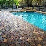 Pool with lanai and brick patio