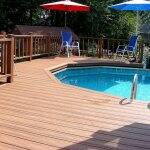 Above-ground pool with composite deck and chairs