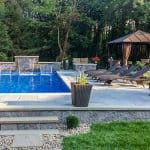 Pool with three fountains, seating and gazebo
