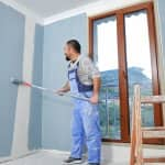 Painter at work painting room blue (Photo by aydinmutlu / E+ via Getty Images)