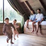 Family spending quality time in wooden attic (Photo by Halfpoint Images/Moment via GettyImages)