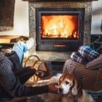Father and son sit near fireplace (Photo by Soloviova Liudmyla - stock.adobe.com)
