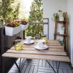 cozy patio with black floor and walls, tan and black furniture, and plants (Photo by Melinda Nagy - stock.adobe.com)