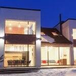 House lit up on snowy night (Photo by Aleksey Sergeychik - stock.adobe.com)