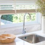 A luxurious kitchen sink in front of a window (Photo by ben-bryant/iStock / Getty Images Plus via Getty Images)