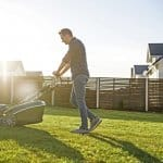 Man mows the lawn on a sunny day (Photo by Вадим Пастух - stock.adobe.com)