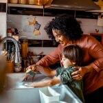 A mother with her son doing the dishes (Photo by Marko Geber/DigitalVision via Getty Images)