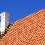 Replacement of roof clay tiles of a wooden house (Photo by Z Dizgalvis/iStock / Getty Images Plus via Getty Images)