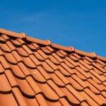 roof tile pattern, close up, over blue sky (Photo by  R.Tsubin / Moment via Getty Images)