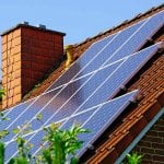 Solar panels on a roof (Photo by Westend61 via Getty Images)