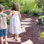 two children walking through backyard landscaping  (Photo by Eurobanks/iStock/Getty Images Plus via Getty Images)